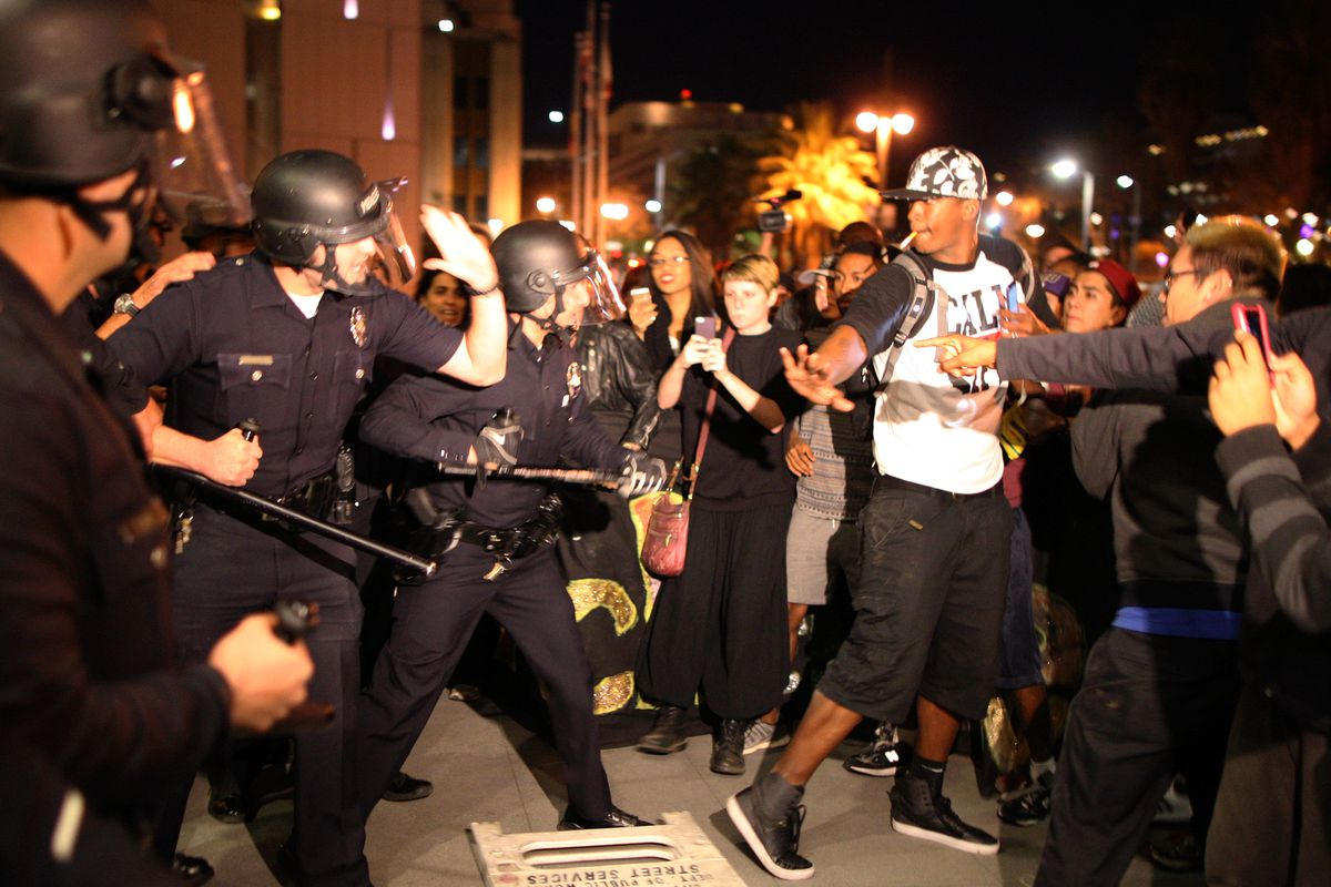 Police and protestors clash in LA after the Ferguson grand jury announcement.