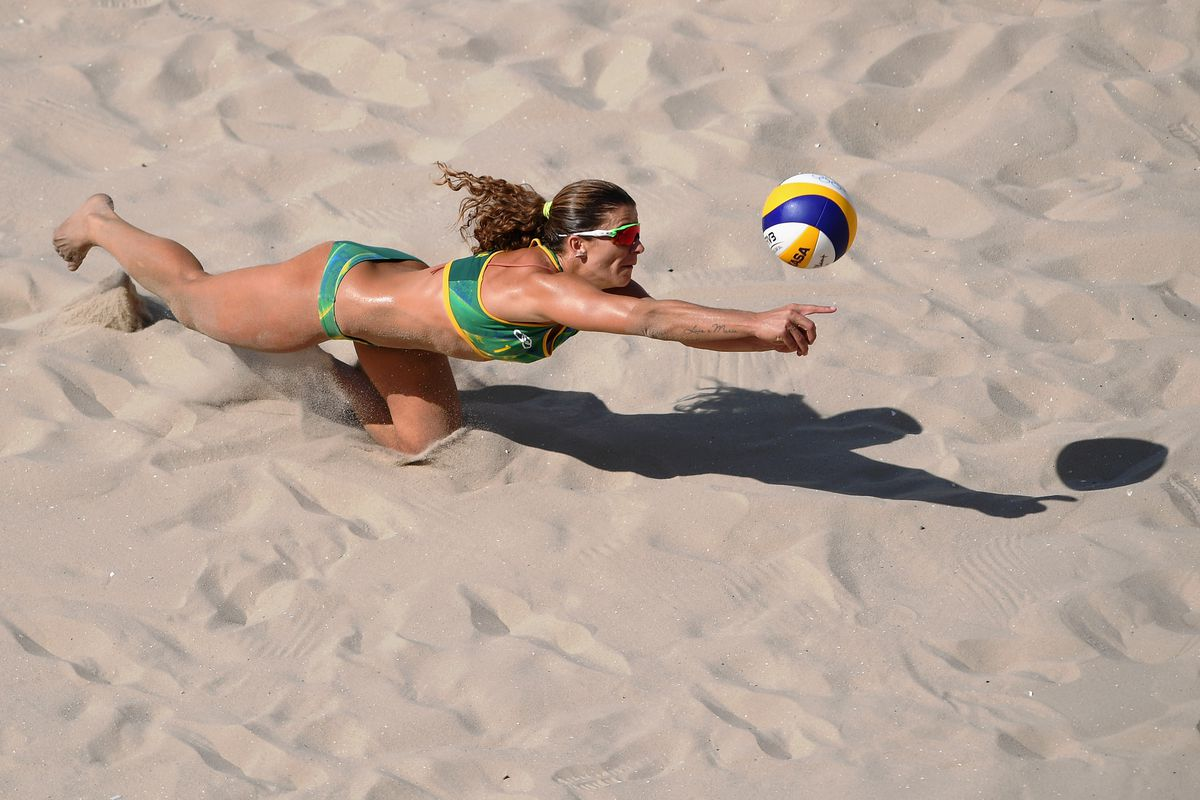 Beach volleyball player Larissa França of Brazil dives for the balll during action in Rio on Sunday.