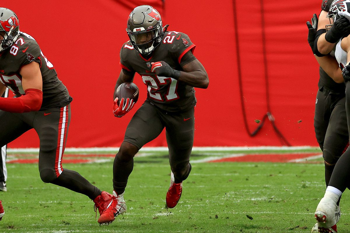 Ronald Jones #27 of the Tampa Bay Buccaneers rushes during a game against the Atlanta Falcons at Raymond James Stadium on January 03, 2021 in Tampa, Florida.