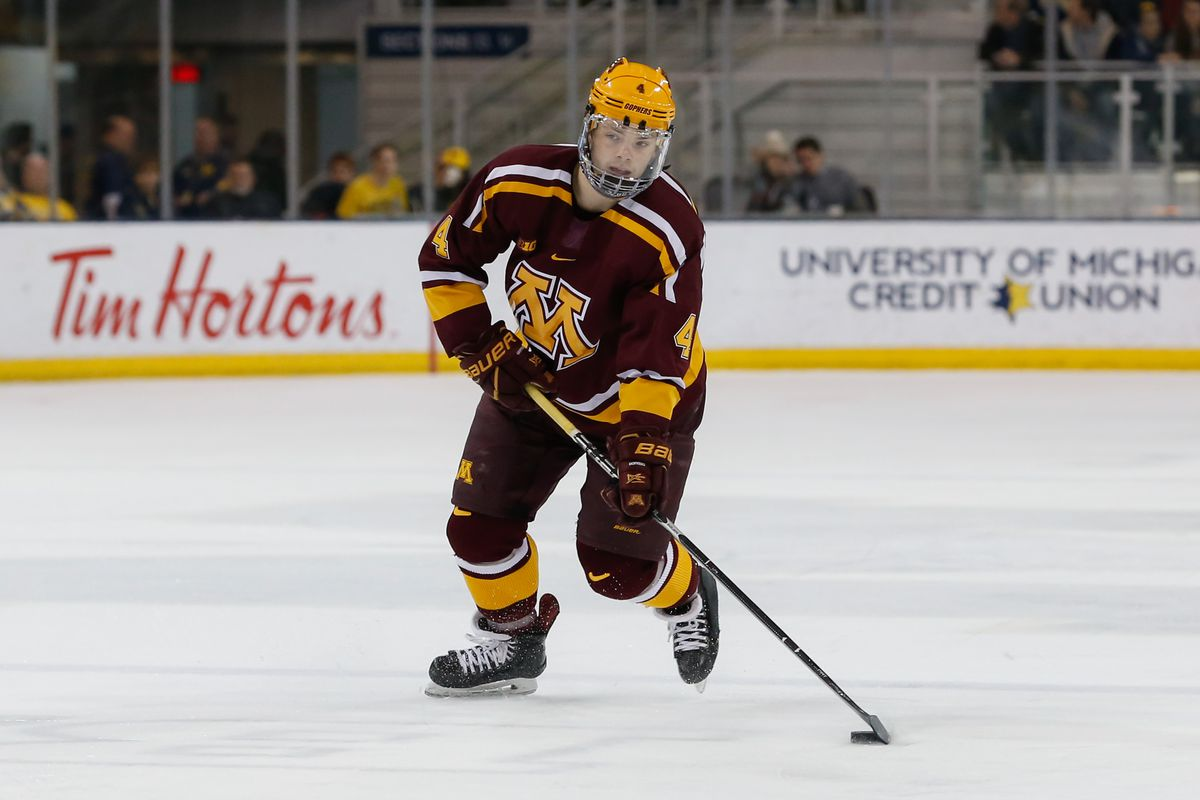 Minnesota Golden Gophers defenseman Ben Brinkman (4) skates with the puck during a regular season Big 10 Conference hockey game between the Minnesota Golden Gophers and Michigan Wolverines on December 8, 2018 at Yost Ice Arena in Ann Arbor, Michigan.