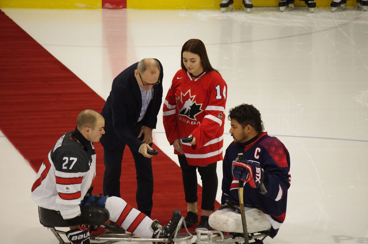 Raphaëlle Tousignant participates in the ceremonial face-off before Game 2 of the Canada-USA sledge hockey development series at the 2017 Défi sportif AlterGo.