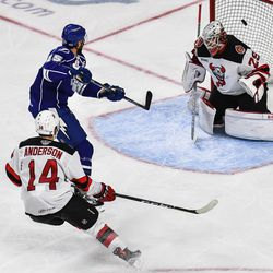 Syracuse Crunch Andy Andreoff (15) redirects the puck past Binghamton Devils goalie Mackenzie Blackwood (29) for a goal in American Hockey League (AHL) action at the Floyd L. Maines Veterans Memorial Arena in Binghamton, New York on Friday, October 19, 2018. Syracuse won 4-0.
