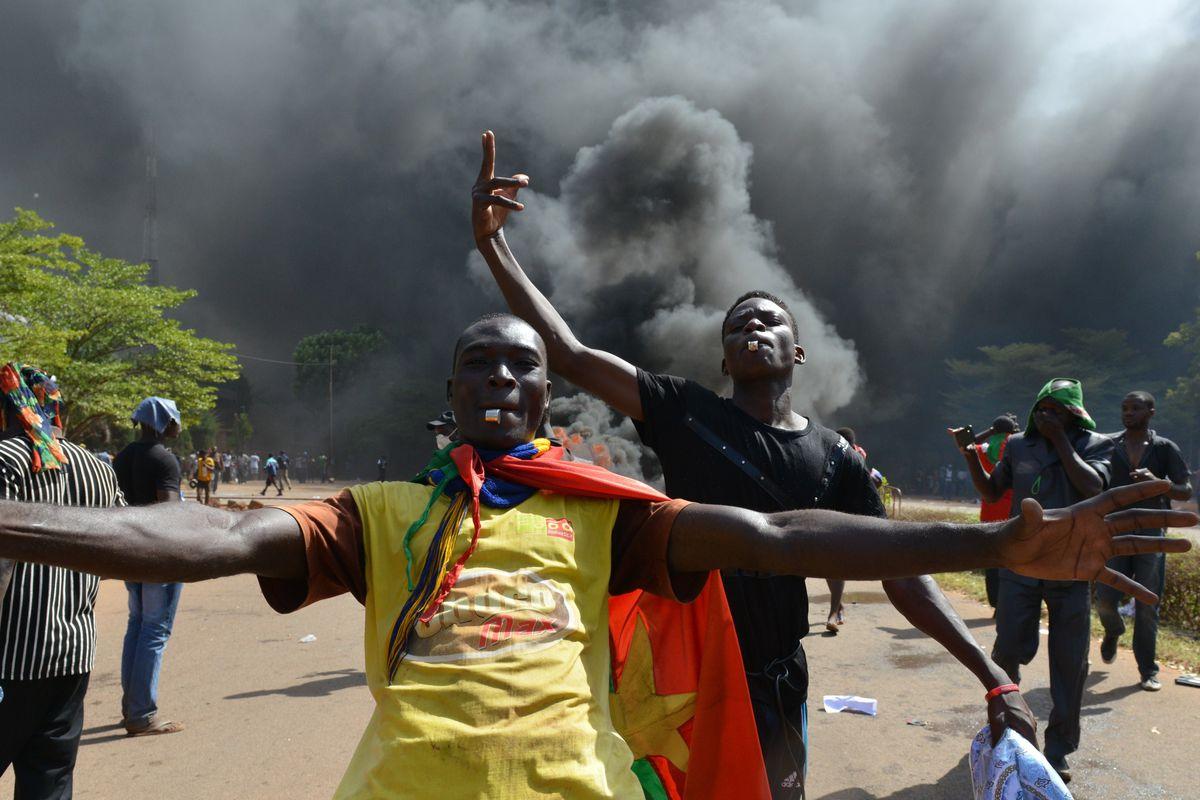 Protestors outside of parliament in Burkina Faso's capital, Ouagadougou.