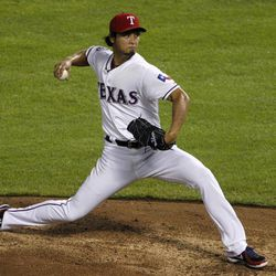 Texas Rangers' Yu Darvish of Japan delivers to the Seattle Mariners in the fifth inning of a baseball game Friday, Sept. 14, 2012, in Arlington, Texas.