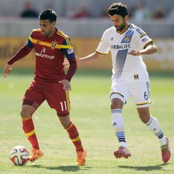 Real Salt Lake midfielder Javier Morales (11) moves the ball past Los Angeles Galaxy midfielder Baggio Husidic (6) during a game at Rio Tinto Stadium on Saturday, March 22, 2014.