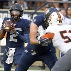 Utah State quarterback Kent Myers (2) looks to throw the ball against Idaho State during an NCAA college football game Thursday, Sept. 7, 2017, in Logan, Utah. (Eli Lucero/Herald Journal via AP)