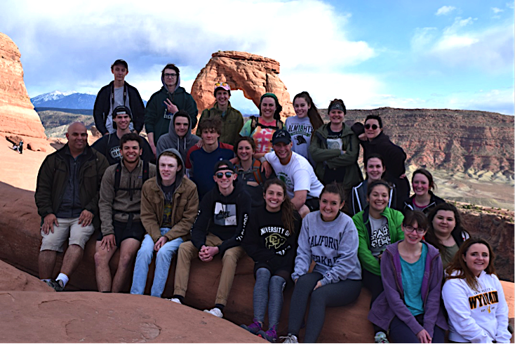 Teacher Daniel Ganoza, first row on left, with his students during their annual trip to Arches National Park.