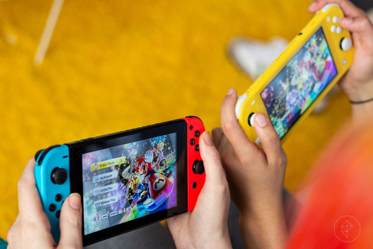 A Nintendo Switch and the new Nintendo Switch small, side by side