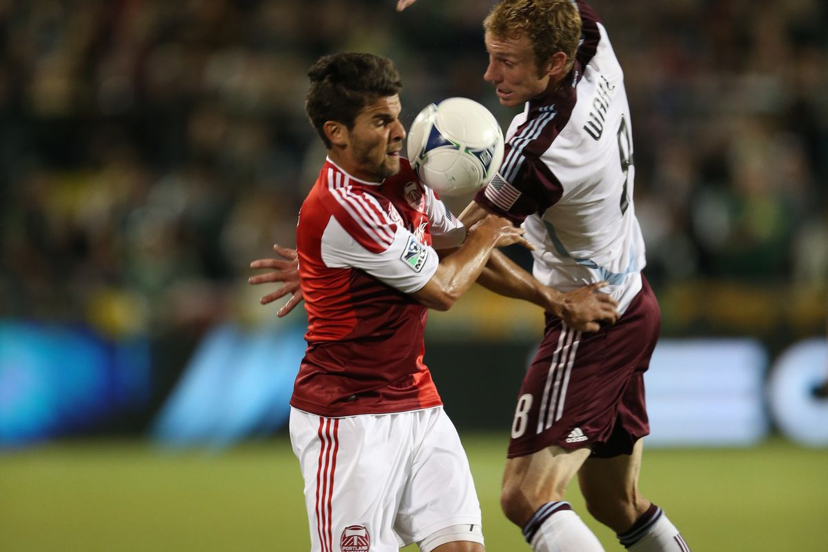 Sal Zizzo #7 of Portland Timbers competes with Tyson Wahl #8 of Colorado Rapids.