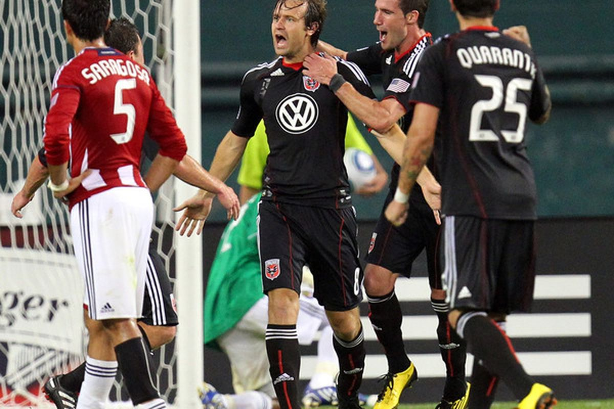 United captain Carey Talley celebrates his winning penalty kick goal