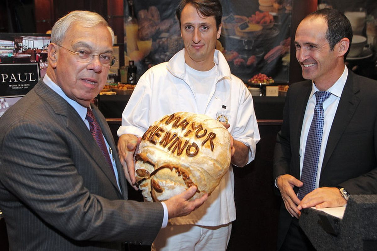 Former mayor Tom Menino breaks bread - and ground - at the upcoming Downtown Crossing location.