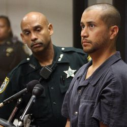 """FILE - In this Thursday, April 12, 2012 file photo, George Zimmerman, right, stands next to a Seminole County Deputy during a court hearing in Sanford, Fla.  Zimmerman has been charged with second-degree murder in the shooting death of the 17-year-old Trayvon Martin. When a recording was released of a 911 call Zimmerman made to police shortly before fatally shooting Martin, some who heard it zeroed in on three words to suggest he had uttered a racial slur. An affidavit released by the prosecutor who has charged Zimmerman with second-degree murder says he did not use a slur, however. The document filed Thursday, April 12, 2012 did say Zimmerman """"profiled"""" Martin. It did not elaborate."""