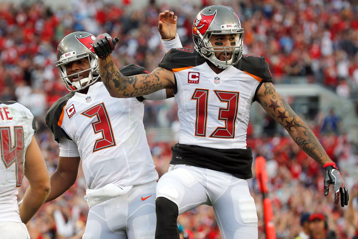 Tampa Bay Buccaneers quarterback Jameis Winston and Tampa Bay Buccaneers wide receiver Mike Evans celebrate against the New York Giants during the first half at Raymond James Stadium.