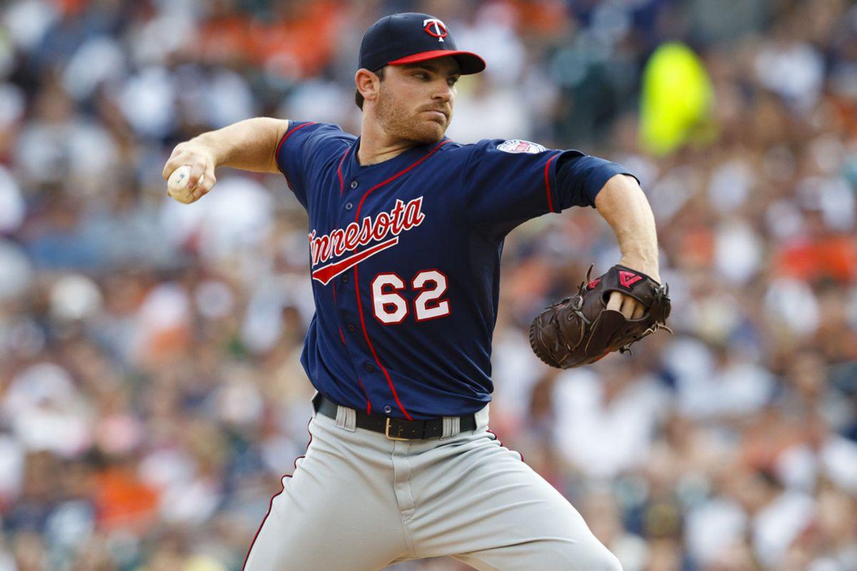 July 2, 2012; Detroit, MI, USA; Minnesota Twins starting pitcher Liam Hendriks (62) pitches against the Detroit Tigers at Comerica Park. Mandatory Credit: Rick Osentoski-US PRESSWIRE