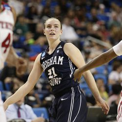 BYU's Lexi Eaton, center, watches her shot during the first half of a first-round game against North Carolina State in the NCAA women's college basketball tournament on Saturday, March 22, 2014, in Los Angeles. (AP Photo/Jae C. Hong)