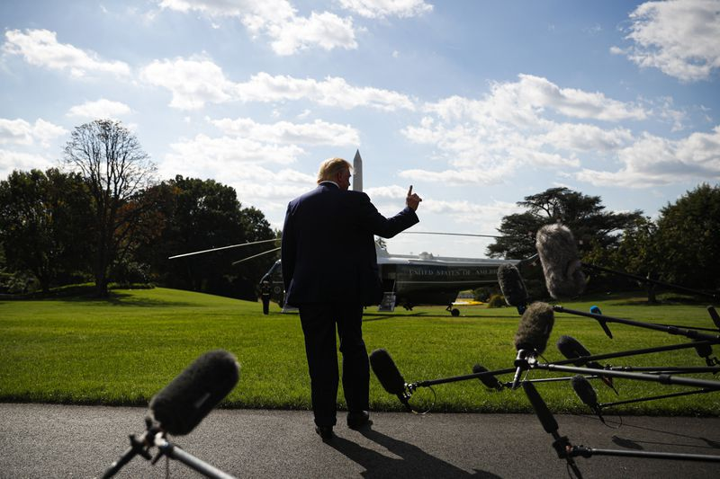 President Trump speaks to reporters before boarding Marine One.