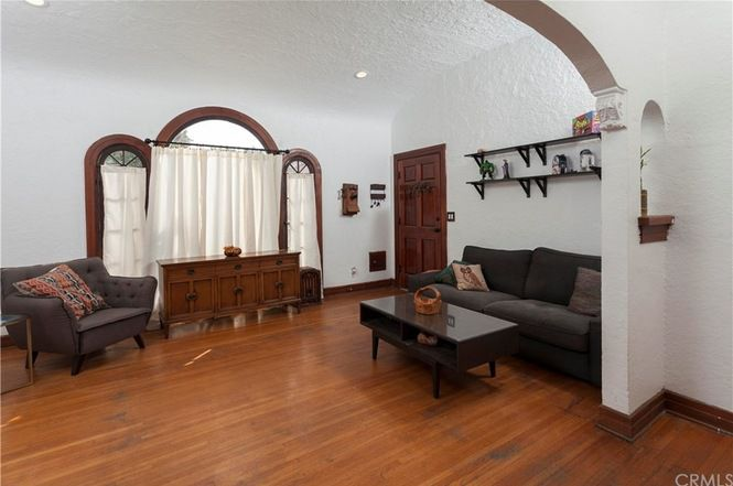 Living room with arched entryway