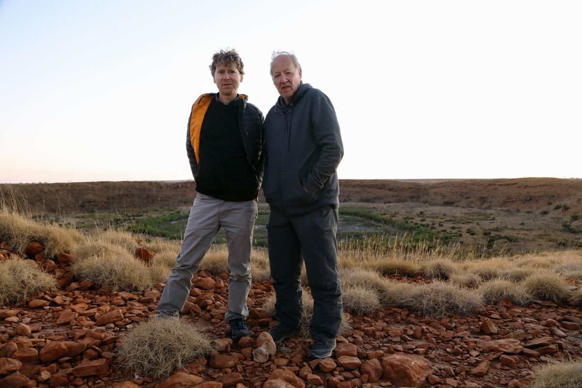Clive Oppenheimer and Werner Herzog standing in the Australian outback