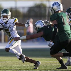 Kearns kick returner Isaiah Afatasi (5) returns a kick during the first half of a high school football game against Olympus at Olympus High School in Holladay on Friday, Aug. 30, 2019.