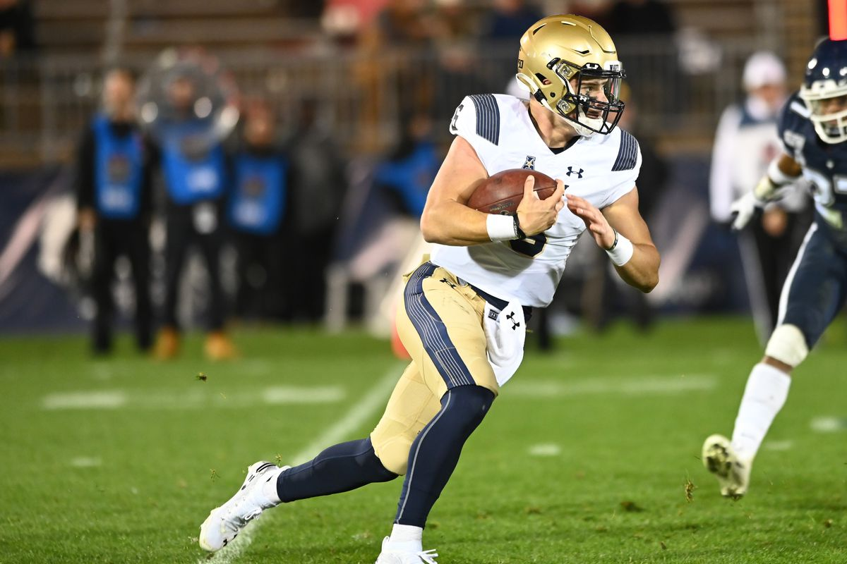 Navy Midshipmen quarterback Perry Olsen carries the ball during the game as the Navy Midshipmen take on the UConn Huskies on November 1, 2019, at Rentschler Field in East Hartford, Connecticut.