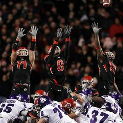Utah defenders successfully distract TCU kicker Ross Evans during the first of two missed field-goal attempts down the stretch of the Utes' 13-10 victory over the Horned Frogs at Rice-Eccles Stadium.