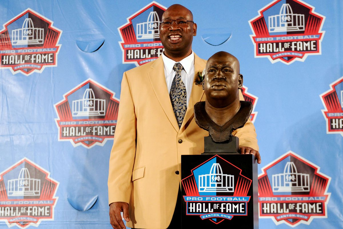 Aug 4, 2012; Canton, OH, USA; Cortez Kennedy poses with his bust at the 2012 Pro Football Hall of Fame Enshrinement at Fawcett Stadium. Mandatory Credit: Tim Fuller-US PRESSWIRE