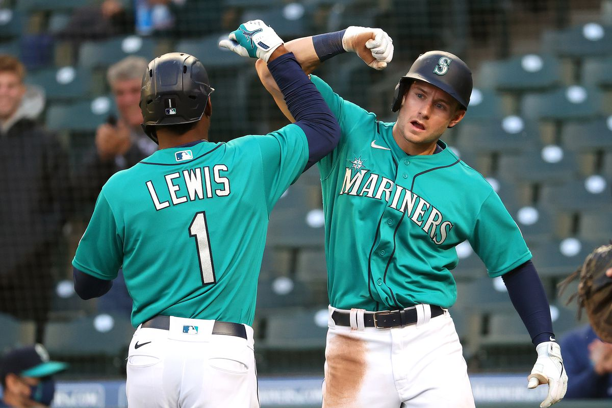 Kyle Lewis #1 celebrates with Jarred Kelenic #10 of the Seattle Mariners after hitting a two-run home run during the third inning against the Texas Rangers at T-Mobile Park on May 28, 2021 in Seattle, Washington.