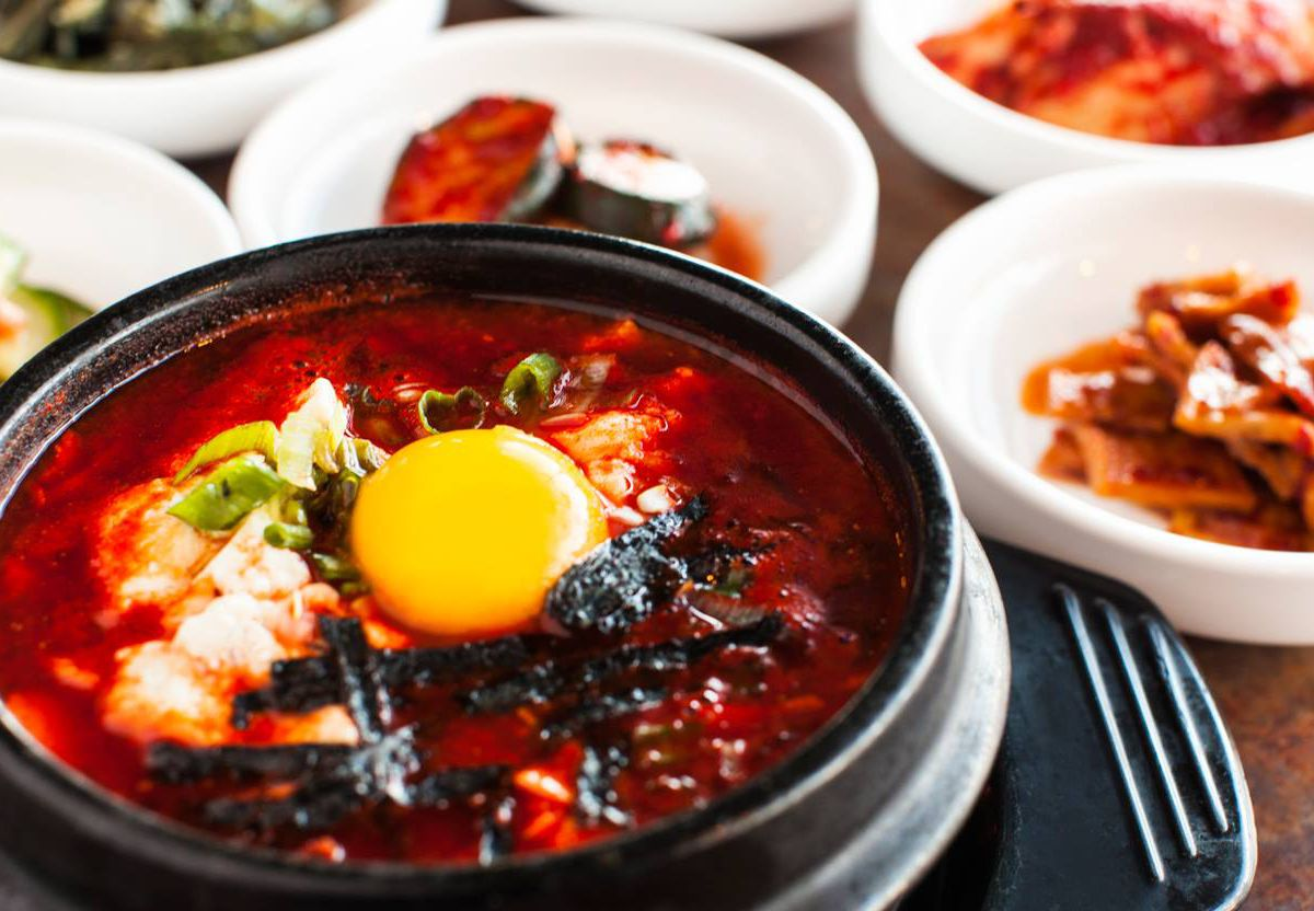 Soondubu jjigae at Korean Tofu House in a pot with sides in the background