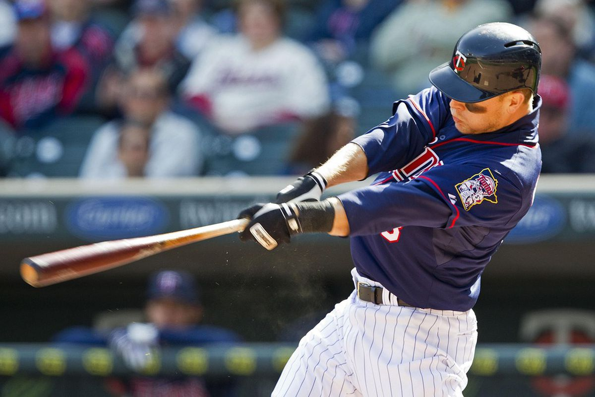 Apr 12, 2012; Minneapolis, MN, USA: Minnesota Twins designated hitter Justin Morneau (33) hits a two run home run in the eighth inning against the Los Angeles Angels at Target Field. The Twins won 10-9. Mandatory Credit: Jesse Johnson-US PRESSWIRE
