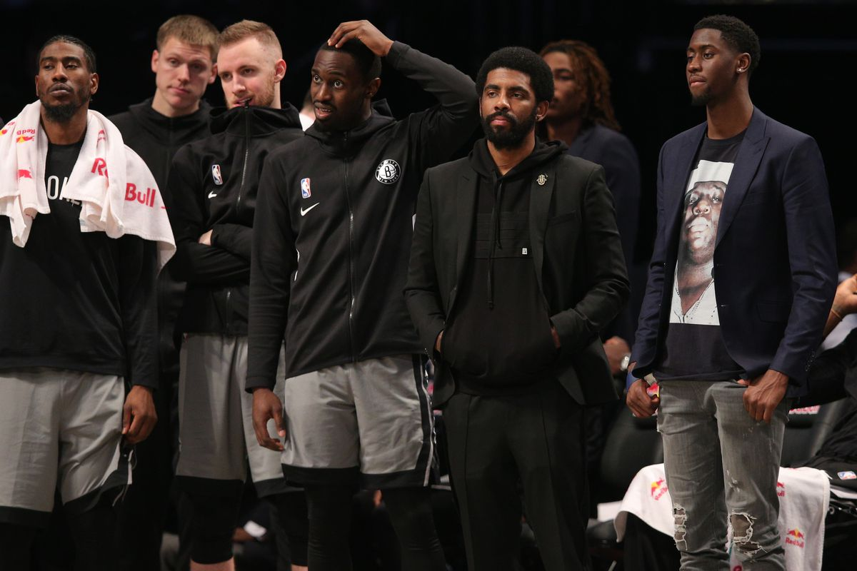 Brooklyn Nets point guard Kyrie Irving and the bench react during the fourth quarter against the Charlotte Hornets at Barclays Center.