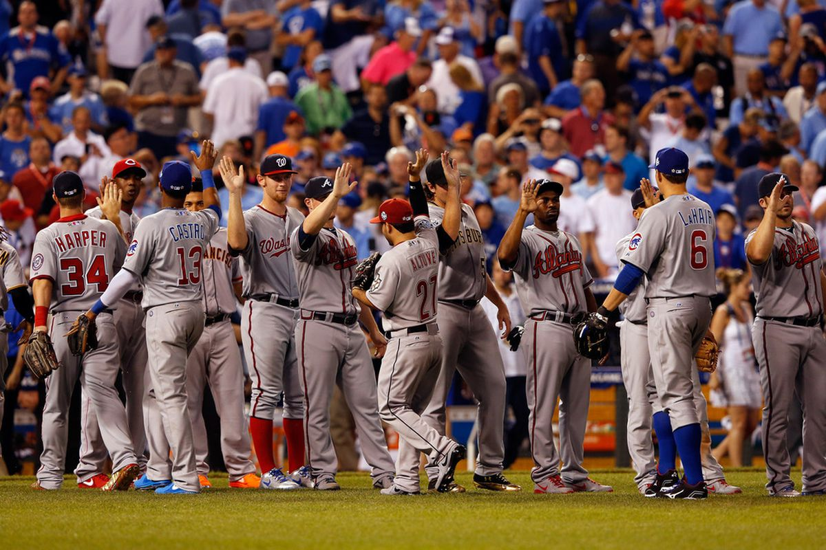 KANSAS CITY, MO - JULY 10:  National League All-Stars celebrate their 8-0 victory agaisnt the American League during the 83rd MLB All-Star Game at Kauffman Stadium on July 10, 2012 in Kansas City, Missouri.  (Photo by Jamie Squire/Getty Images)