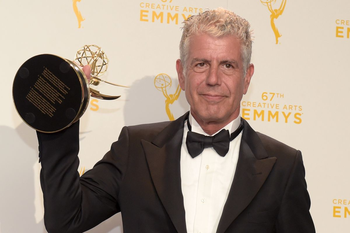 """Anthony Bourdain with his Emmy for """"Parts Unknown"""""""