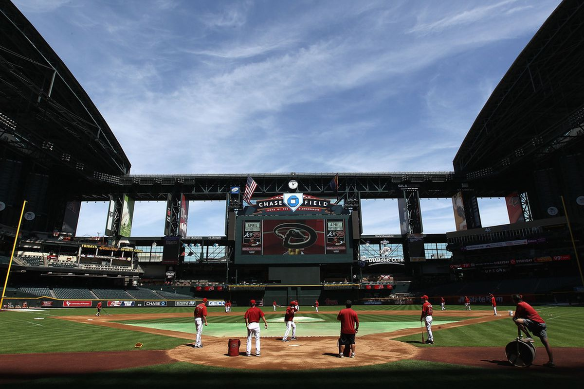 PHOENIX, AZ - APRIL 04:  The Arizona Diamondbacks warm up before the spring training game against the Milwaukee Brewers at Chase Field on April 4, 2012 in Phoenix, Arizona.  (Photo by Christian Petersen/Getty Images)