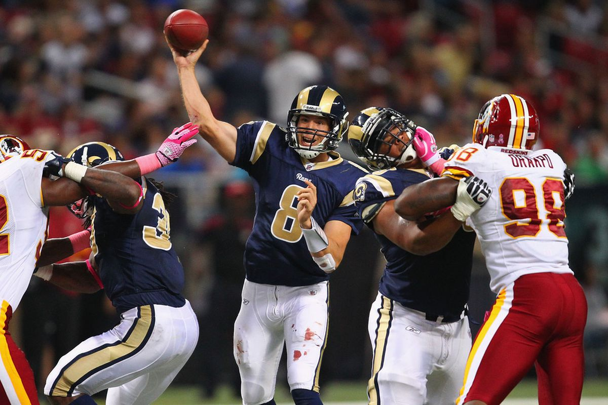 Sam Bradford of the St. Louis Rams passes the ball against the St. Louis Rams at the Edward Jones Dome on October 2, 2011.