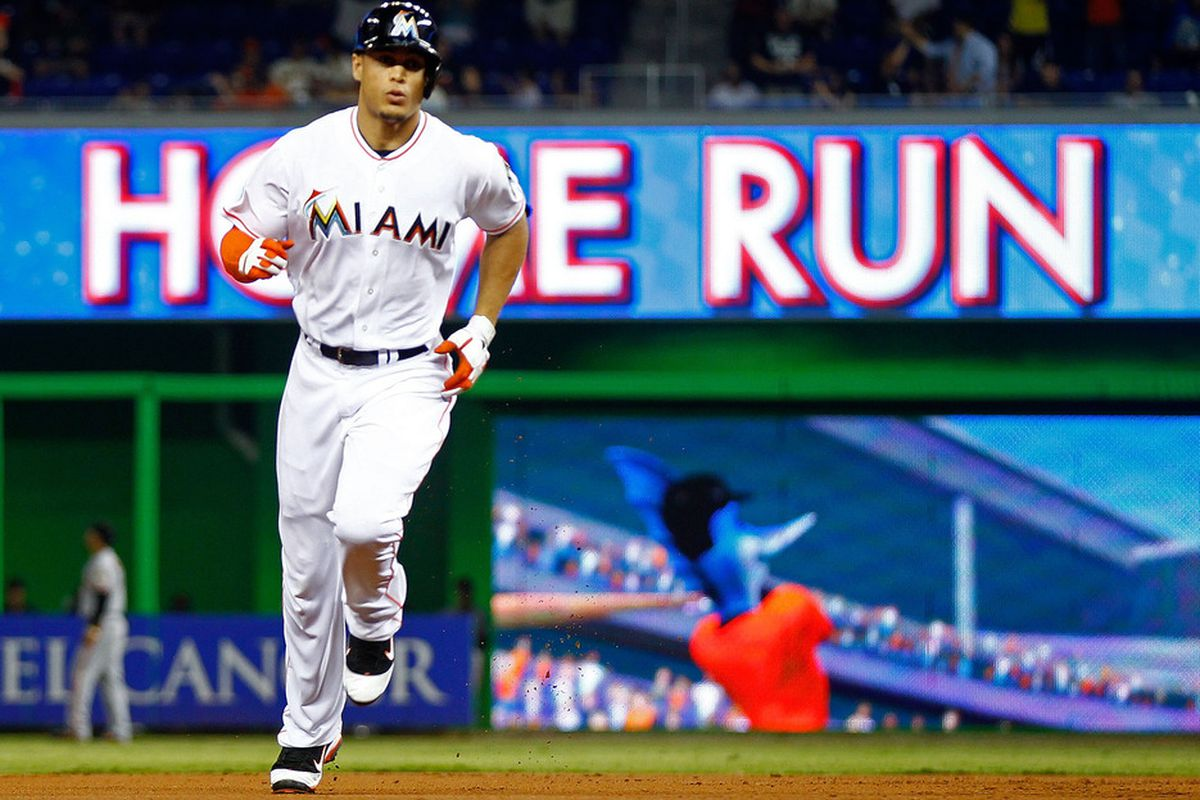 MIAMI, FL - MAY 24:  Giancarlo Stanton #27 of the Miami Marlins hits a solo home run during a game against the San Francisco Giants at Marlins Park on May 24, 2012 in Miami, Florida.  (Photo by Mike Ehrmann/Getty Images)
