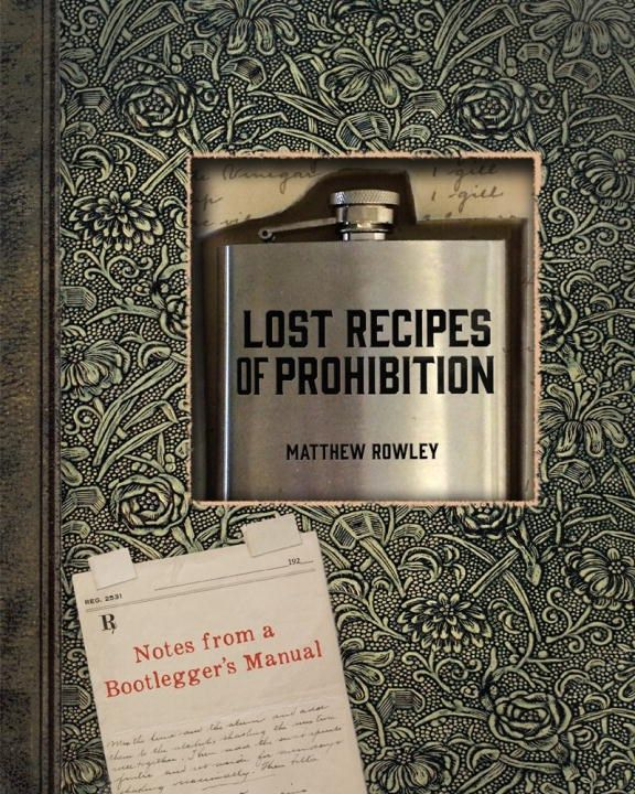 A flask and cocktail book