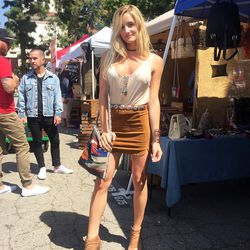 Model Emily Palos went vintage hunting in a suede mini.