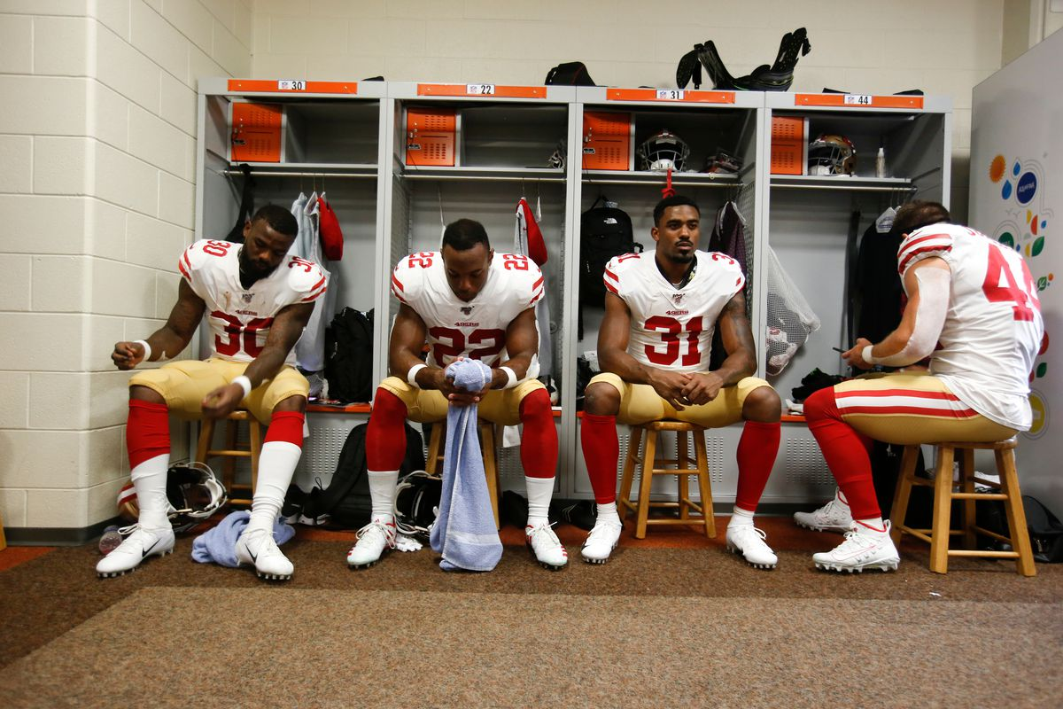 Jeff Wilson Jr., Matt Breida, Raheem Mostert and Kyle Juszczyk of the San Francisco 49ers sit in the locker room prior to the game against the Cincinnati Bengals at Paul Brown Stadium on September 15, 2019 in Cincinnati, Ohio.