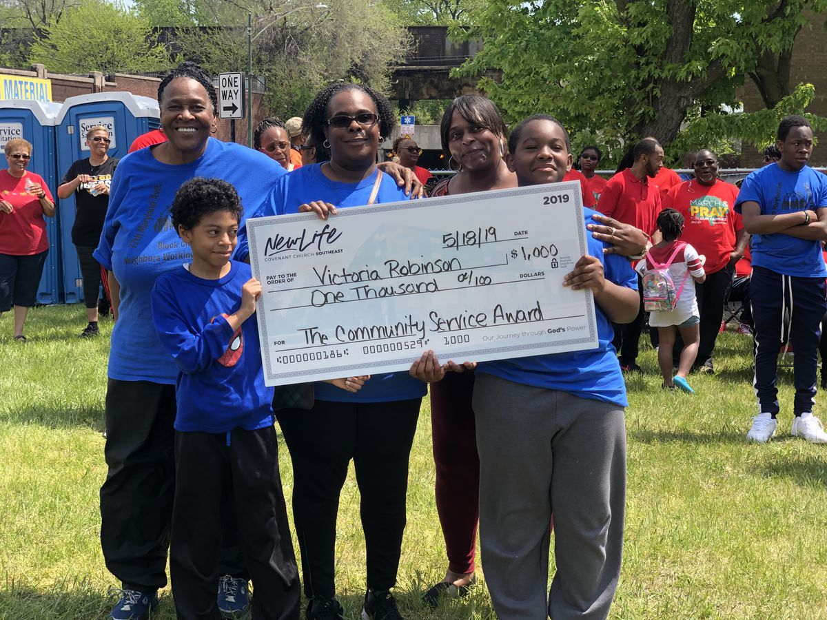 Victoria Robinson was one of four members of New Life Covenant Church to receive a $1,000 check on Saturday in appreciation of her community service.
