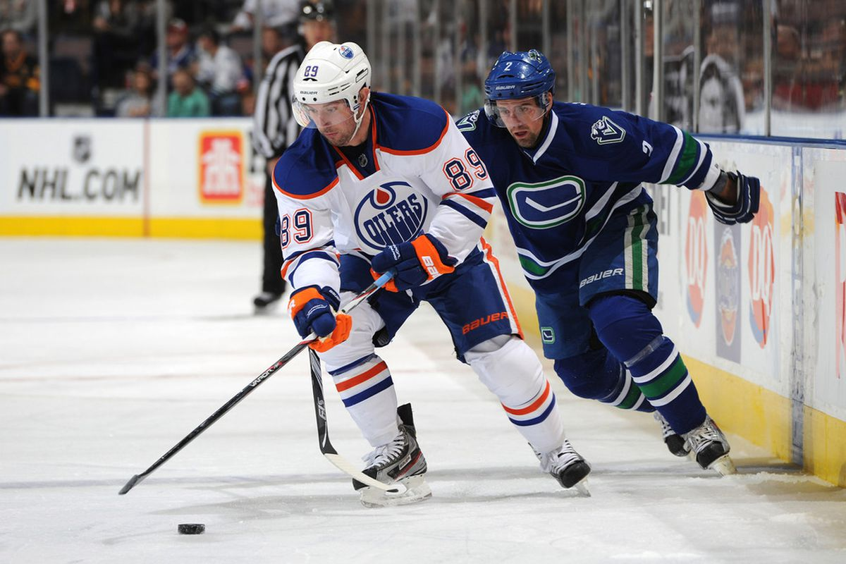 EDMONTON, CANADA - OCTOBER 25: Sam Gagner #89 of the Edmonton Oilers is followed closely by Dan Hamhuis #2 of the Vancouver Canucks on October 25, 2011 at the Rexall Place in Edmonton, Alberta, Canada. (Photo by Dale MacMillan/Getty Images)