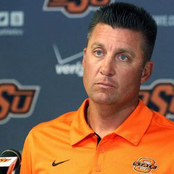 Oklahoma State head coach Mike Gundy listens to a question during an NCAA college football news conference in Stillwater, Okla., Monday, Sept. 24, 2012. Gundy believes injured starting quarterback Wes Lunt could return to practice by the end of this week, although he's still uncertain whether he'll be able to play in Saturday night's game against Texas.