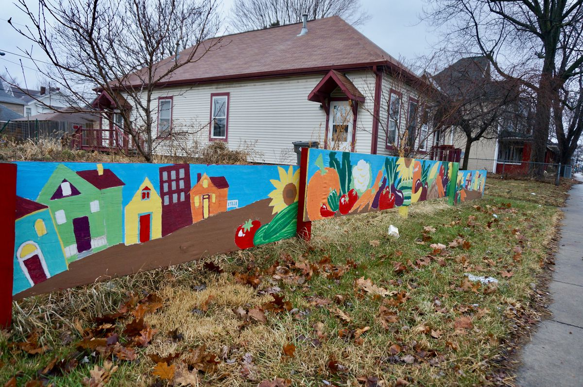 A mural brings a spark of color to an empty lot across the street from Englewood Christian Church. The church runs a community development corporation that has been instrumental in revitalizing the neighborhood around School 15.
