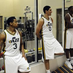 The Jazz's Trey Burke, left, Enes Kantor, center, and Derrick Favors wait around in between photos during media day at the Zions Bank Basketball Center on Monday, September 30, 2013.