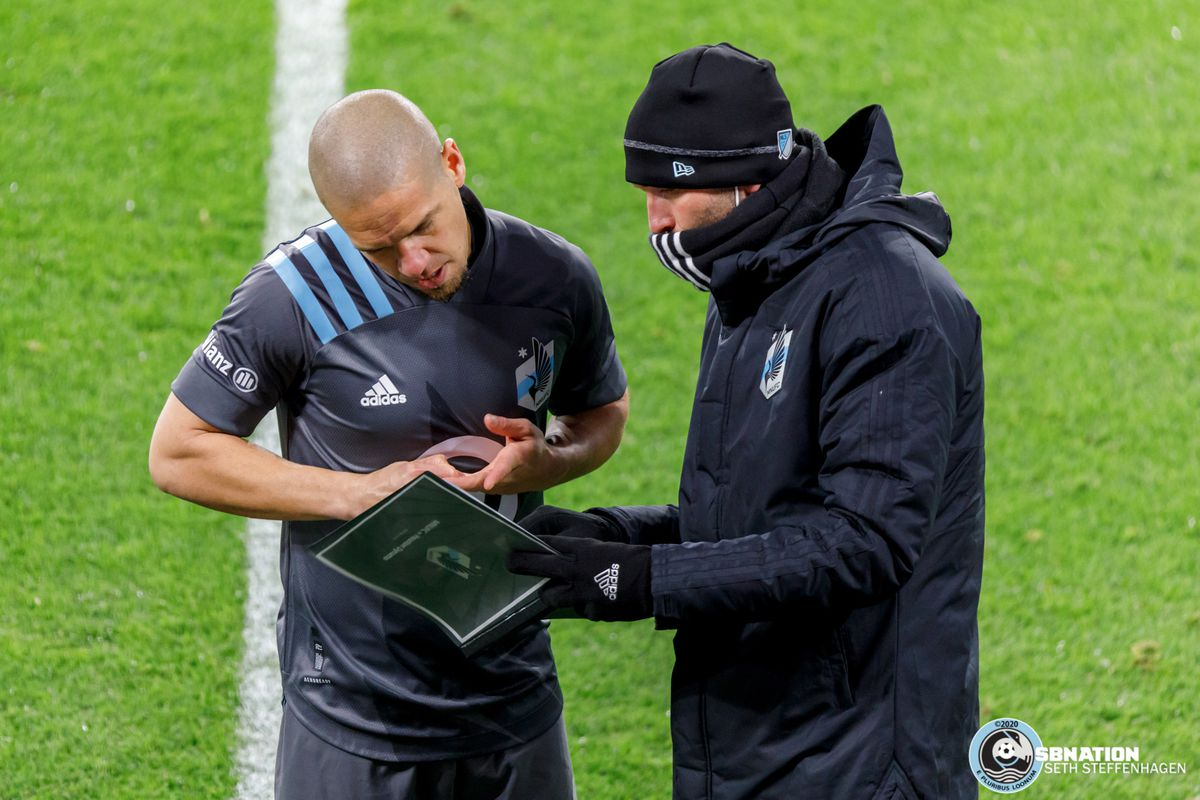 October 18, 2020 - Saint Paul, Minnesota, United States - Minnesota United midfielder Osvaldo Alonso (6) takes instructions from Minnesota United assistant coach Ian Fuller before being subbed on during the match against Houston Dynamo match at Allianz Field.