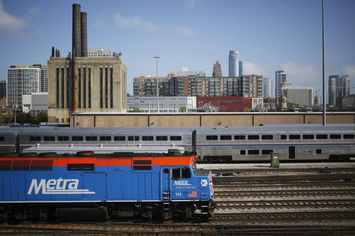 a blue and red Metra commuter train travels through Chicago