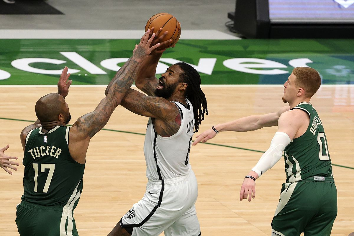 DeAndre Jordan of the Brooklyn Nets is defended by P.J. Tucker of the Milwaukee Bucks during the first half of a game at Fiserv Forum on May 02, 2021 in Milwaukee, Wisconsin.