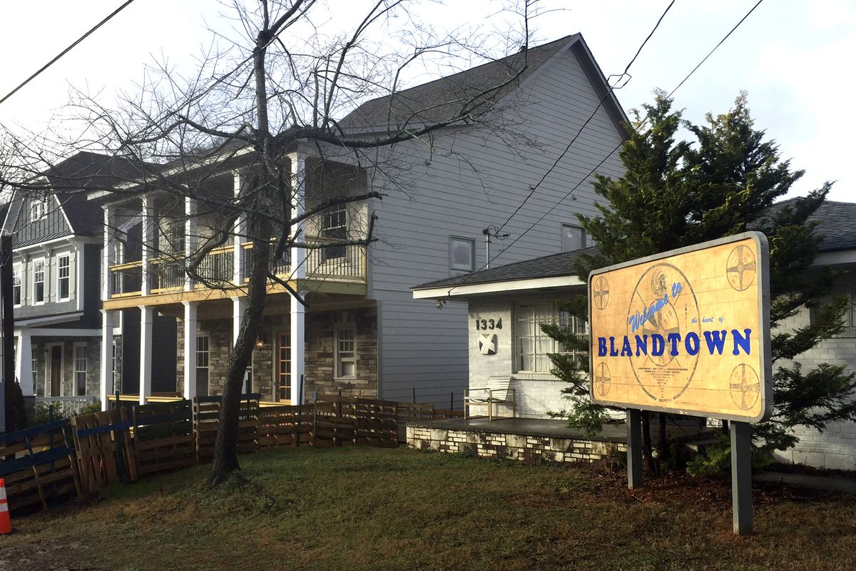 The Blandtown Atlanta sign in Turk's front yard. The neighbors probably love this guy.