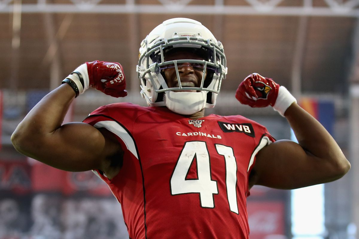 Running back Kenyan Drake #41 of the Arizona Cardinals celebrates after scoring on a five yard rushing touchdown against the Cleveland Browns during the first half of the NFL game at State Farm Stadium on December 15, 2019 in Glendale, Arizona.