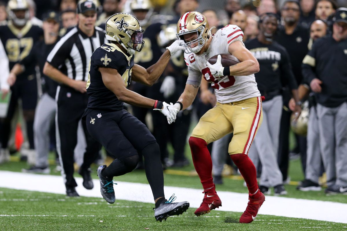New Orleans Saints free safety Marcus Williams grabs the facemark of San Francisco 49ers tight end George Kittle in the second half at the Mercedes-Benz Superdome.