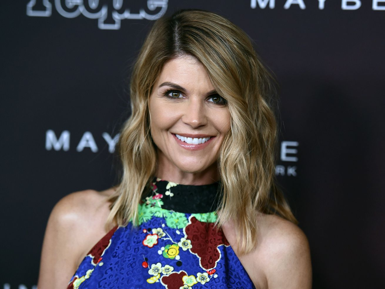 """FILE - In this Oct. 4, 2017 file photo, actress Lori Loughlin arrives at the 5th annual People Magazine """"Ones To Watch"""" party in Los Angeles. The FBI says Loughlin has been taken into custody in connection with a scheme in which wealthy parents paid bribe"""